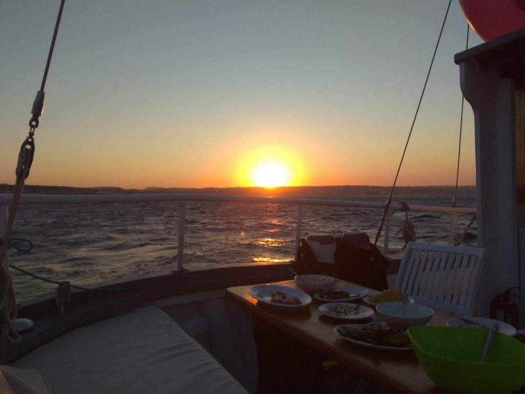 Sunset Cruise with a swimming stop at Kalithea Bay